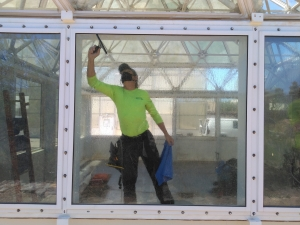 Greg Spencer applying window tint to SAM at Biosphere 2