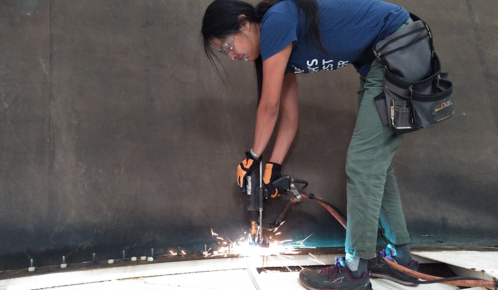 Colleen Cooley using a stud welder at SAM, Biosphere 2